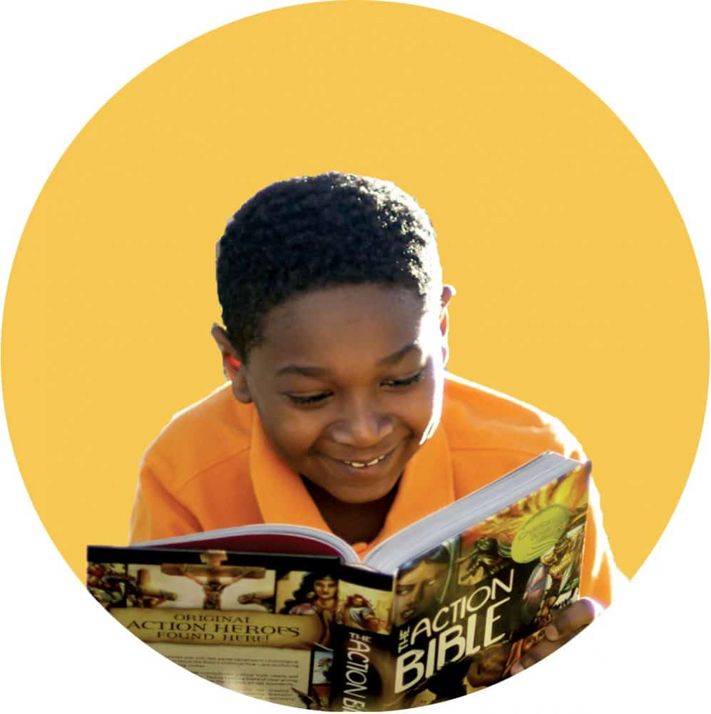 Young boy reads read The Action Bible