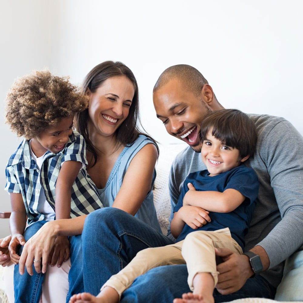 A family laughs and connects with one another.