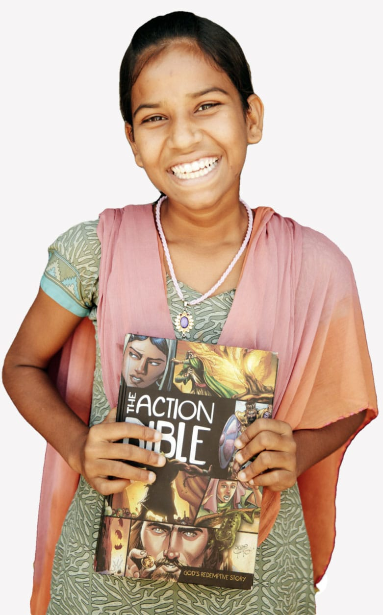 Teenager hold The Action Bible