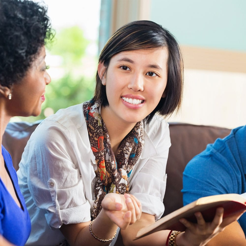Young woman leads a discipleship group.