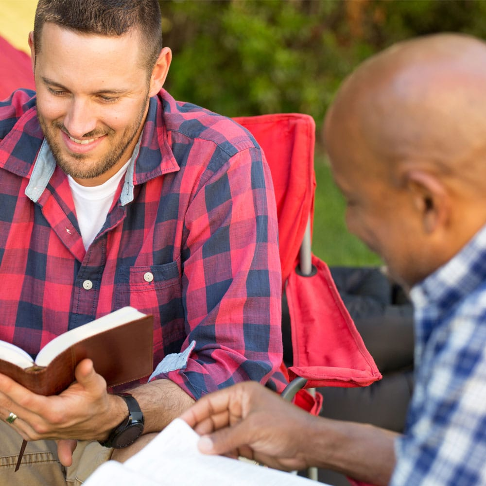 Two men study the bible together.